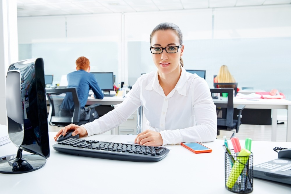 Brunette glasses businesswoman working in office with computer
